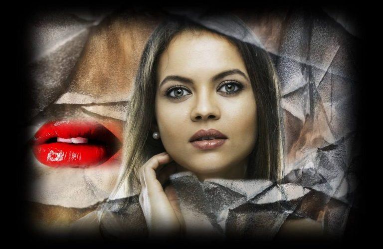רוצה שפתיים מושלמות כמו של אנג'לינה ג'ולי תמונה של דוגמנית עם שפתיים עבות ואודם אדום.